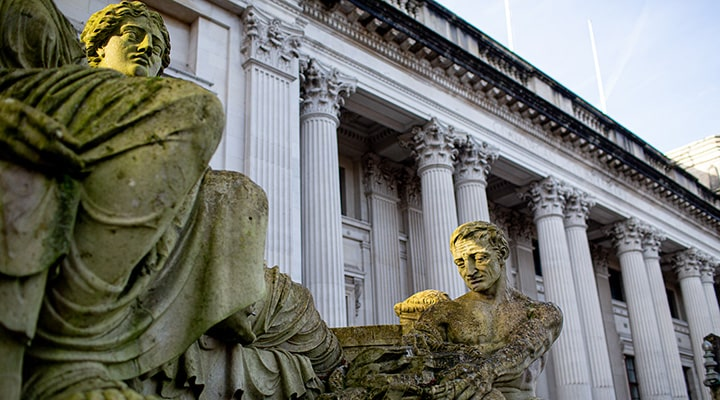 Old grecian statue in front of civic buildings in Cardiff