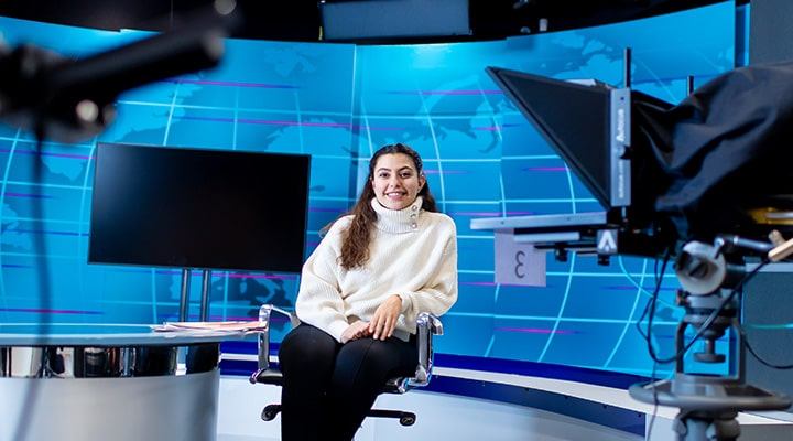 Student in TV studio at Cardiff University school of journalism